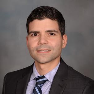 Michael de la Cruz, MD