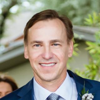 Erik Strelnieks, MD