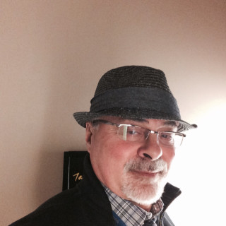 Ermes Cogliani, MD
