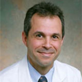 Carlos Alvarez, MD